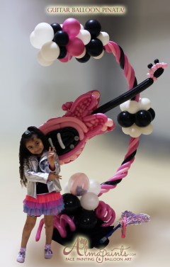 balloon pinata in San Antonio, balloon art in San Antonio, balloon decor in San Antonio, Almapaints, guitar theme parties, girls rock, Alma Vasquez