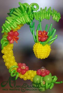 balloon pinata in San Antonio, balloon art, balloon decor in San Antonio, pinata, fruit, pineapple, Almapaints